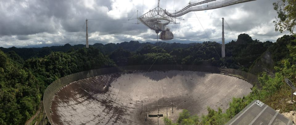 Arecibo Telescope, the world's largest radio telescope. The dish is made of perforated aluminium panels.